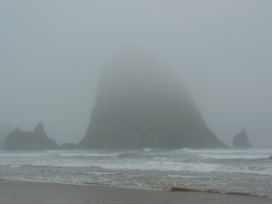 ...the looming dark features of Haystack Rock are revealed.