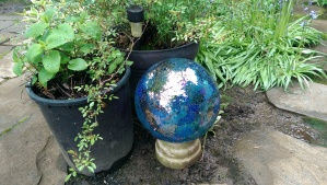 The new gazing ball, honoring the hold one; this one already broken, a mosaic of shattered glass.