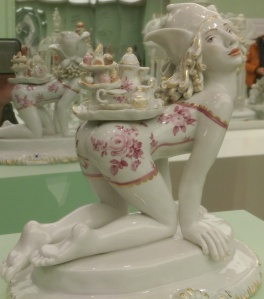 Whimsical porcelain figurine; Meissen on display at the Portland Art Museum.