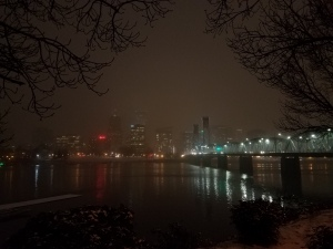A hazy skyline on a snowy night.