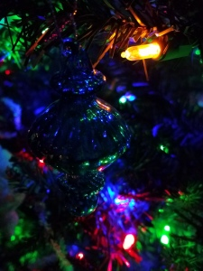 For now, the lights on the tree still shine.
